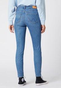 Wrangler - Jeansy Skinny Fit - mottled blue - 1
