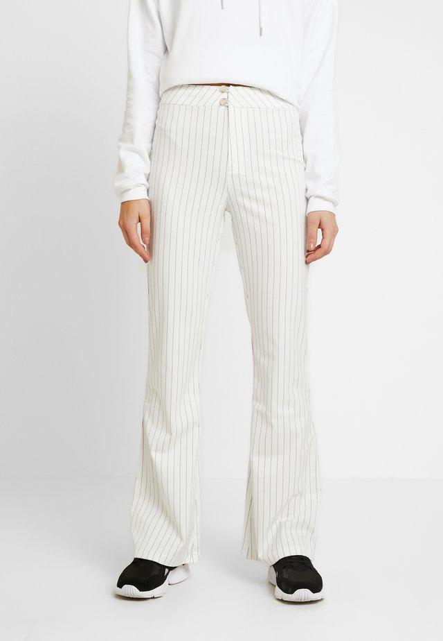 STYLE FLARED PANTS DODI - Tygbyxor - white