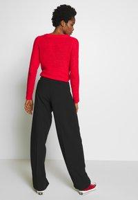 WRSTBHVR - PANTS ROSIE - Trousers - black - 2