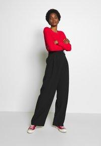 WRSTBHVR - PANTS ROSIE - Trousers - black - 1
