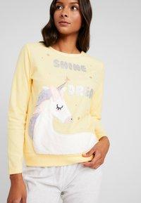 Women Secret - UNICORN SET - Pyžamová sada - yellow melange - 3