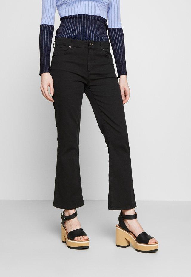ELIDE - Jeans a zampa - schwarz