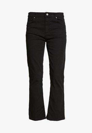ELIDE - Flared jeans - schwarz