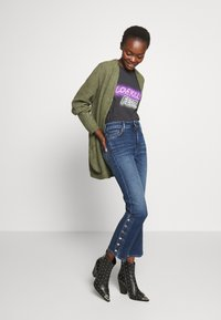 Sportmax Code - BETULLA - Flared Jeans - scurro used - 1