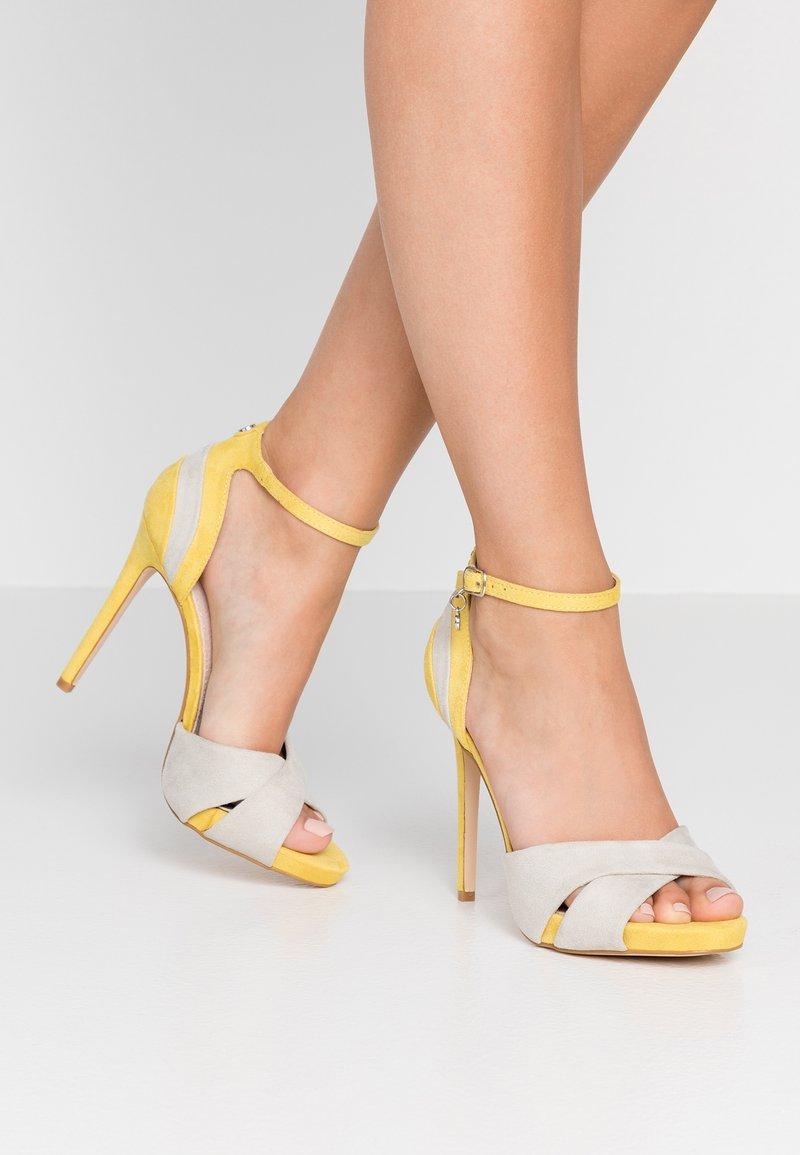 XTI - High heeled sandals - yellow