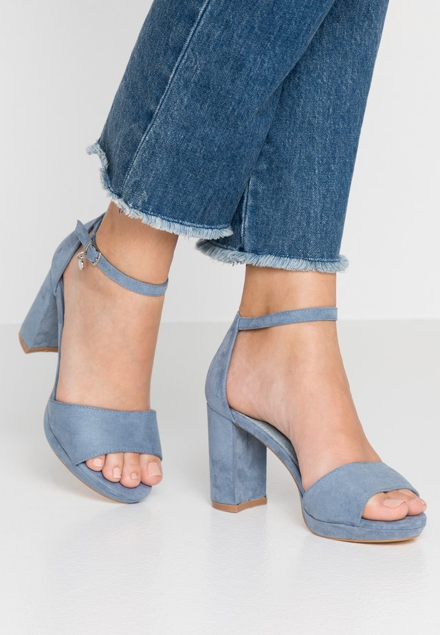 High heeled sandals - jeans