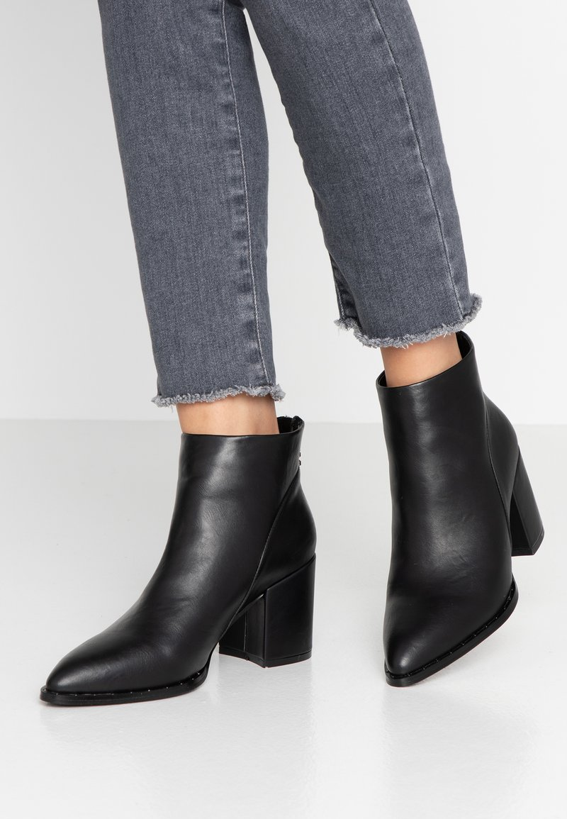 XTI - Ankle boots - black