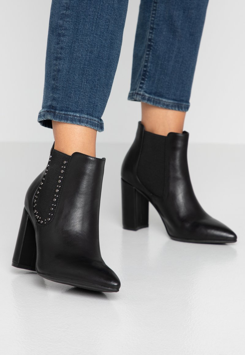 XTI - High heeled ankle boots - black