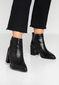 XTI - Ankle boot - black - 0
