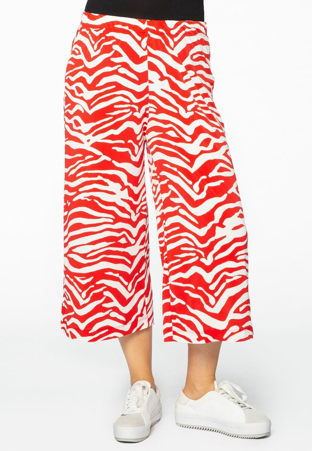 ANIMAL PRINT - Stoffhose - red