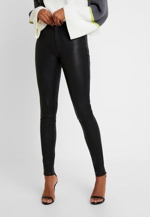 YASZEBA - Leggingsit - black