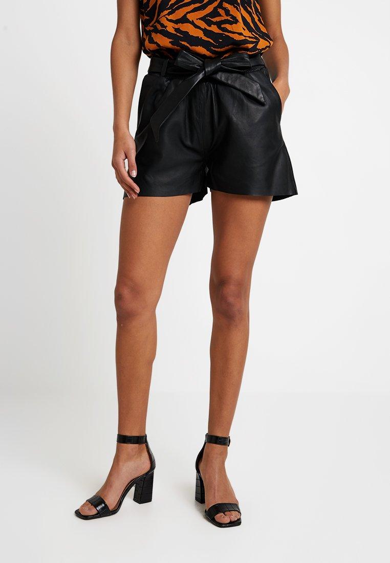 YAS - YASNIA - Leather trousers - black