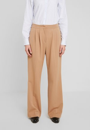 COREY - Trousers - almond skin