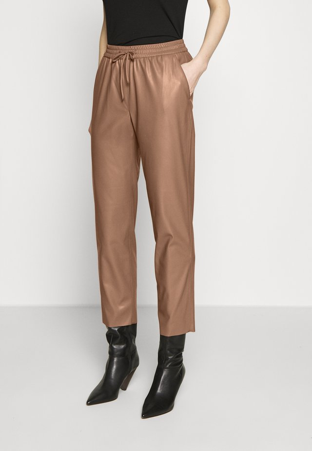 CARILO - Trousers - bambi