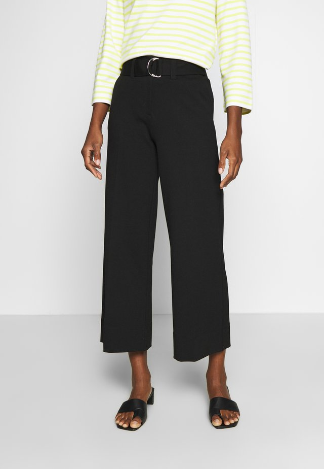 CHILANI - Trousers - black