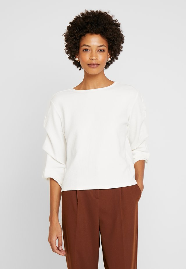 KASONDA SOLID - Long sleeved top - milk
