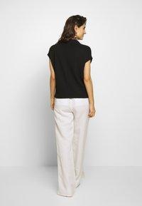 someday. - KITTUA TEXTURE - T-shirts - black - 2