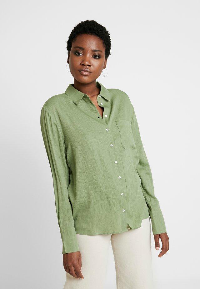 ZITA - Button-down blouse - garden green