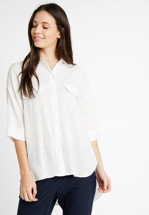 ZERIKA - Button-down blouse - milk