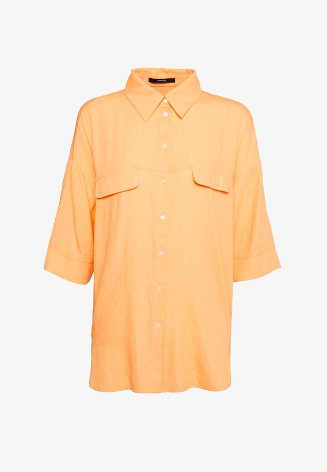 ZERIKA - Button-down blouse - silky orange