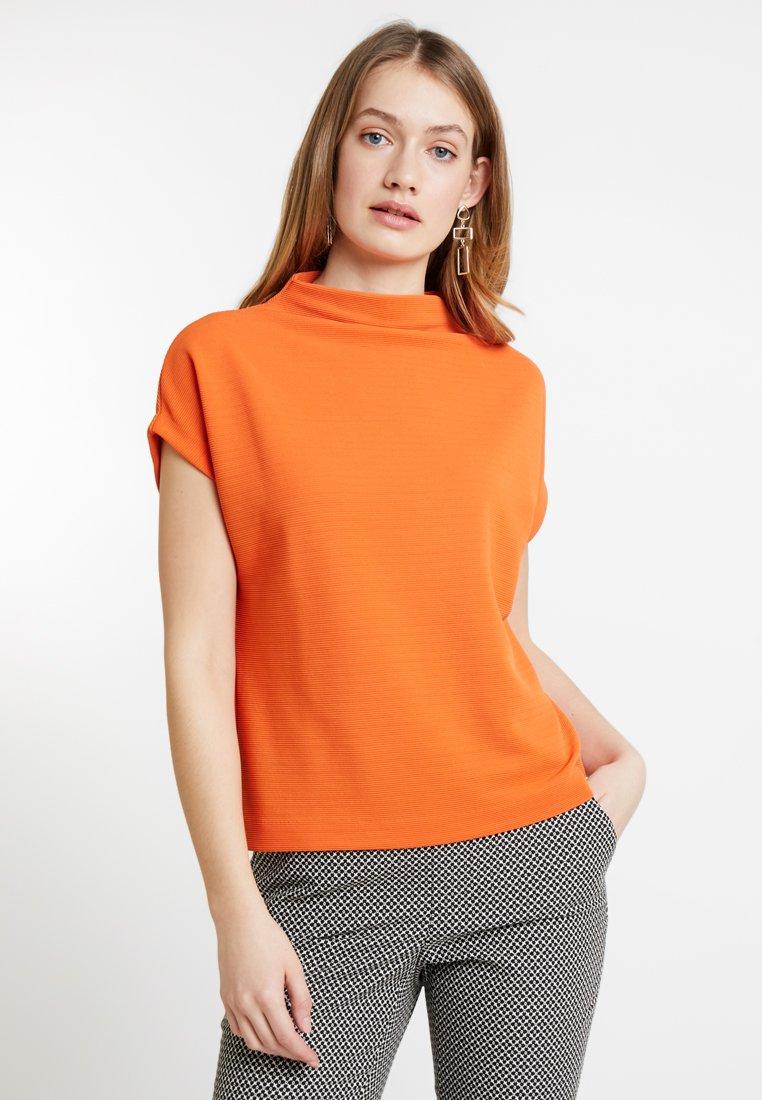 someday. - KITTUA - Basic T-shirt - papaya