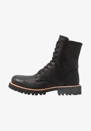 KANSAS - Lace-up boots - black