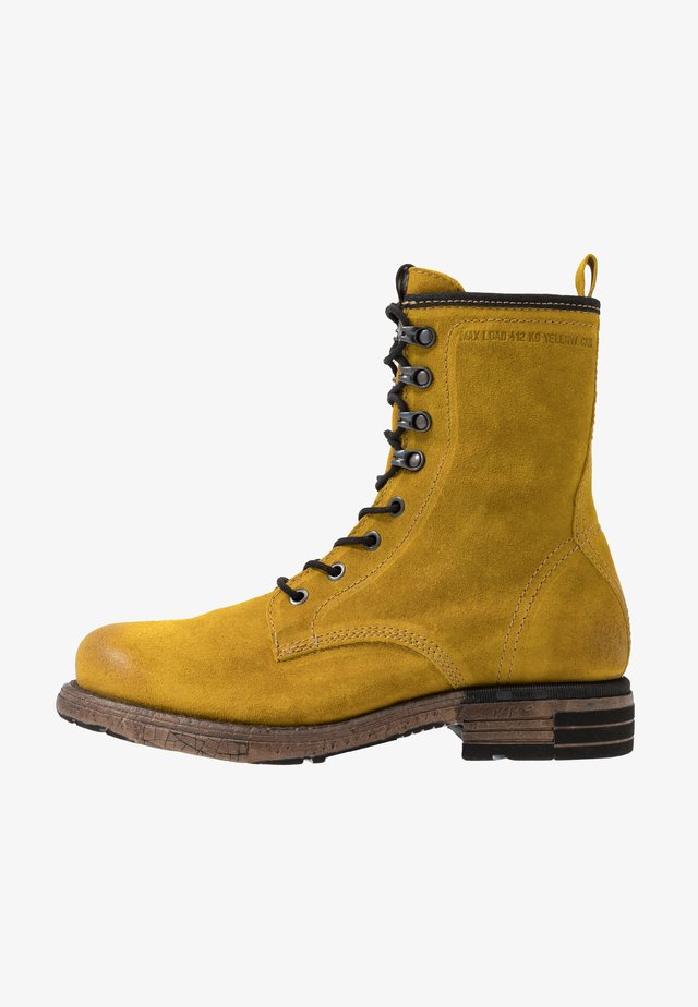 UTAH - Lace-up ankle boots - yellow