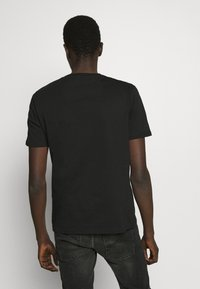 YOURTURN - Basic T-shirt - black - 2