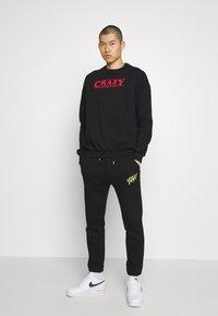 YOURTURN - UNISEX - Sweater - black - 1
