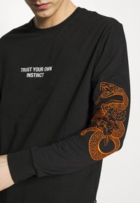 YOURTURN - Long sleeved top - black - 6