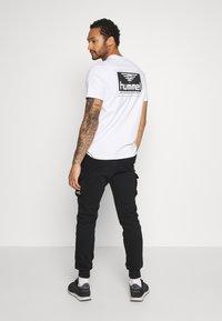 YOURTURN - Teplákové kalhoty - black - 2