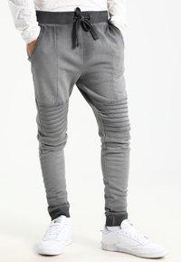 YOURTURN - Teplákové kalhoty - black - 0