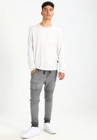 YOURTURN - Teplákové kalhoty - black - 1