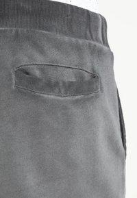 YOURTURN - Teplákové kalhoty - black - 4