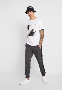 YOURTURN - Spodnie treningowe - grey - 1