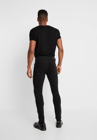 YOURTURN - Vaqueros pitillo - black denim - 2