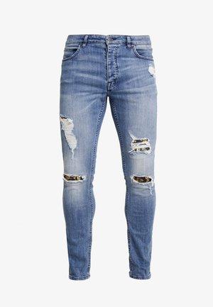 Jeans Skinny Fit - destroyed denim