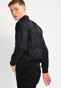 YOURTURN - Bomber bunda - black - 2