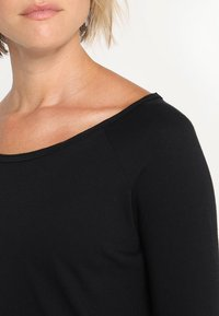Yogasearcher - KARANI - Long sleeved top - black - 3