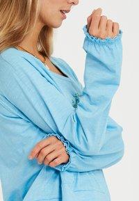 Yogasearcher - Longsleeve - light blue - 4