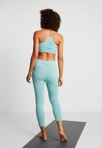 Yogasearcher - SHANTI - Legging - celadon - 2