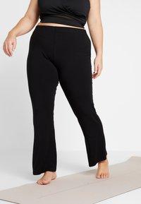 YOGA CURVES - PANTS FLARED LEGS - Pantaloni - black - 0