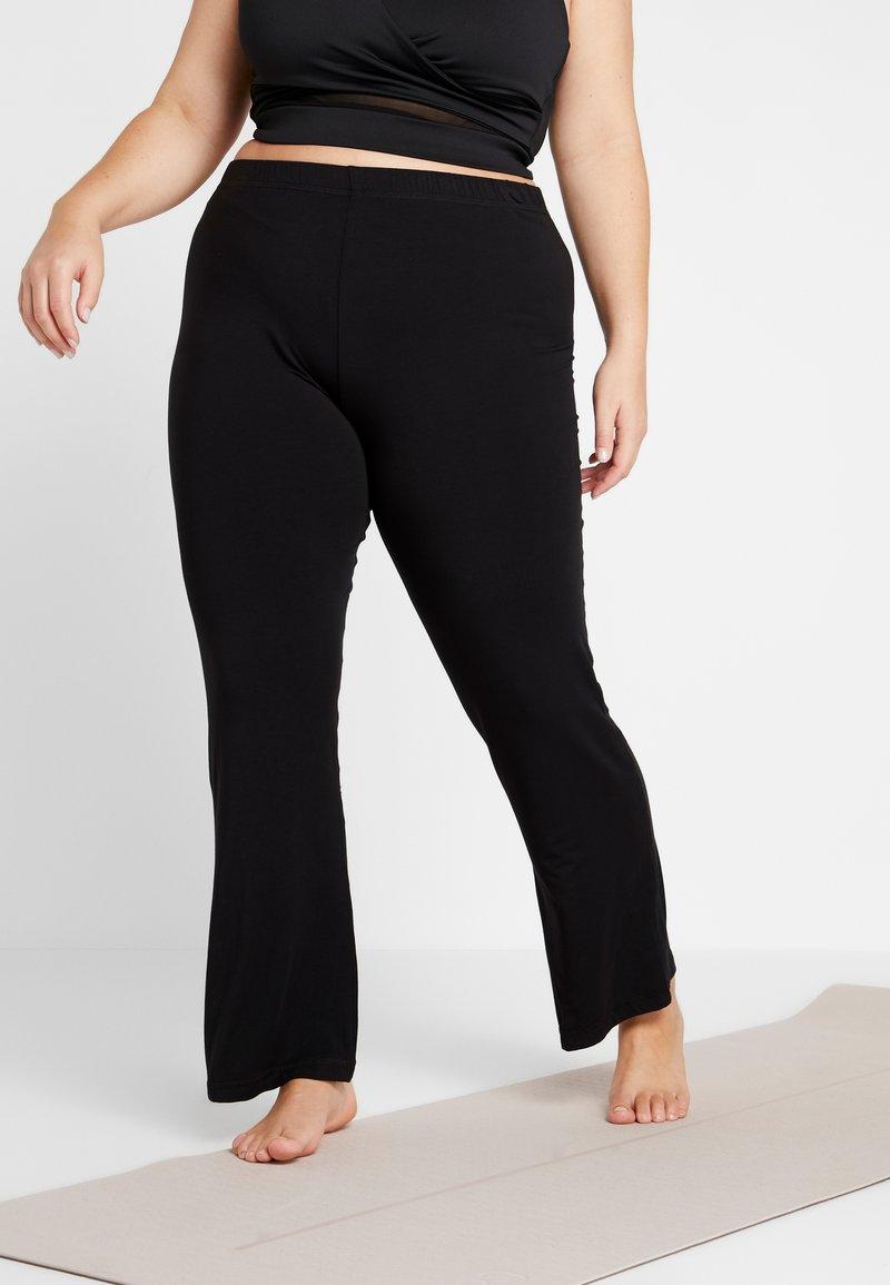 YOGA CURVES - PANTS FLARED LEGS - Pantalones - black