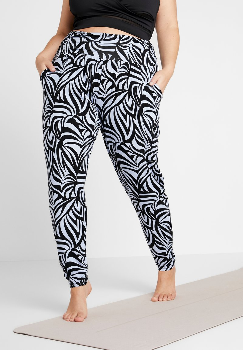 YOGA CURVES - PANTS LONG LOOSE ROLL DOWN - Tracksuit bottoms - blue