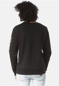 Young and Reckless - Sweatshirt - black - 1