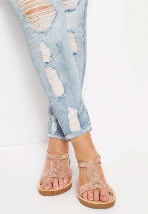 DIAMANTE TWIST  - T-bar sandals - gold