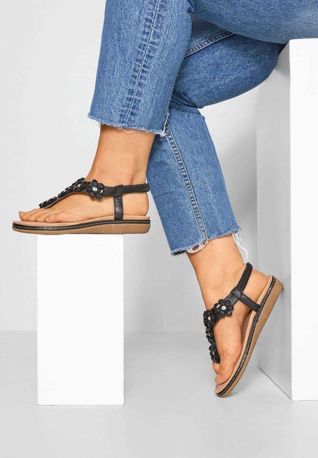 FLOWER DIAMANTE - T-bar sandals - black