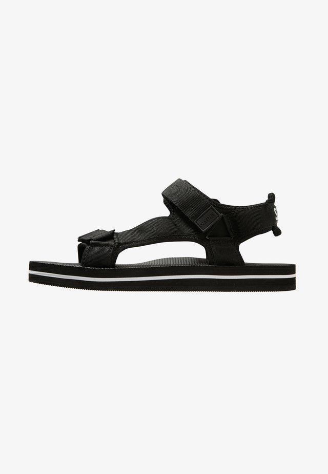 NEVIS - Pantolette flach - black/white