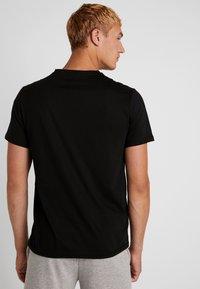 Your Turn Active - T-shirt med print - jet black - 2