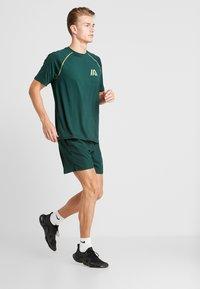 Your Turn Active - Print T-shirt - dark green - 1